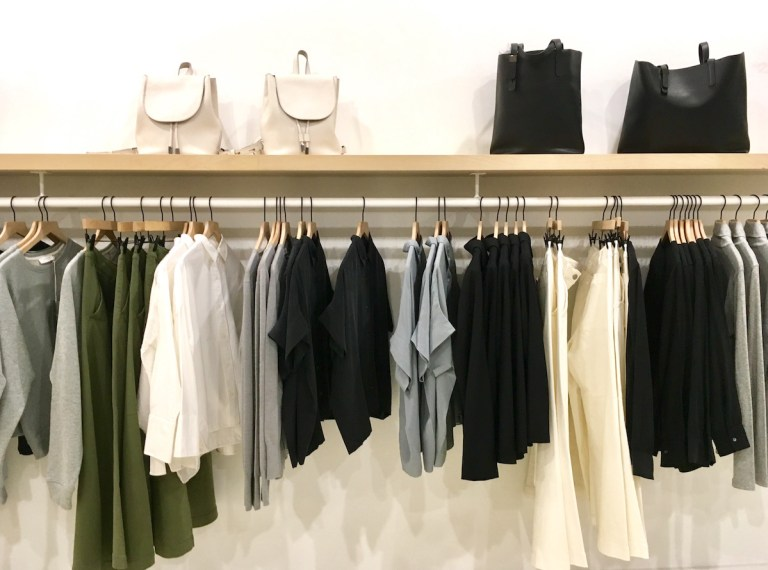 Clothes hanging from a rack at Everlane.