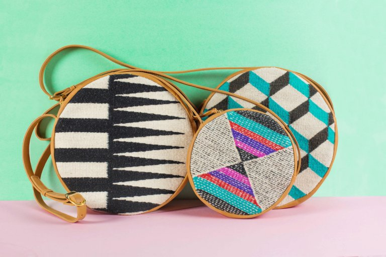 Circular purses made with woven textiles and leather.