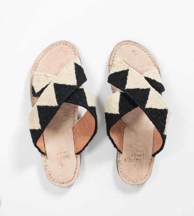 Slide sandals with black and white textiles.
