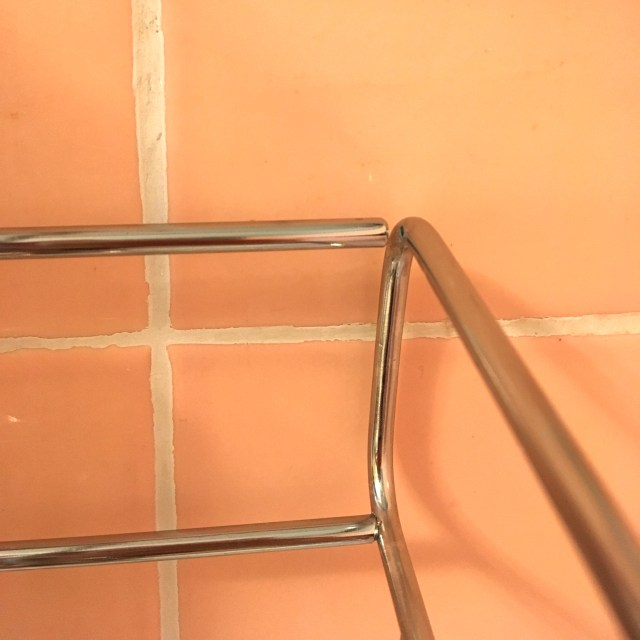 Corner of the Simple Human adjustable shower caddy, which has broken.