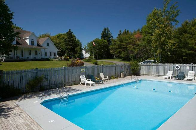 Relax along the pool at Anne's Windy Poplars.