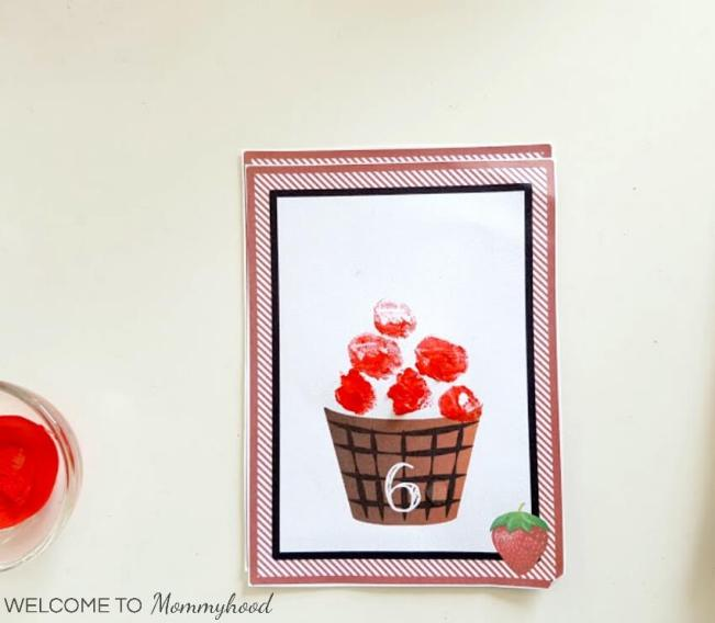 Looking for a fun and easy to set up activity for your toddler? Checkout this painting for toddlers: Strawberry basket number activity with FREE printables #paintingfortoddlers #toddlerart