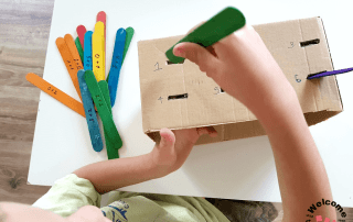 Create this super simple Popsicle stick addition craft for hands-on learning with your kids. They will love practicing math skills, developing fine motor skills, and more with this learning activity!