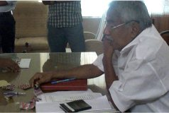 Ommen Chandy inspecting iron folic tablets