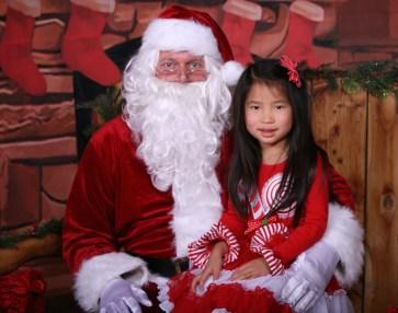 She knows Santa isn't real, but still enjoyed the visit