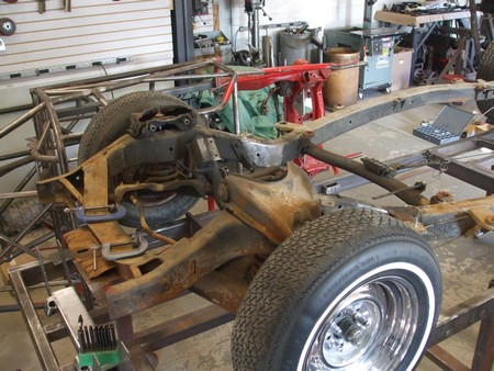 A '57 Ford frame has the springs mounted inside the frame rails.