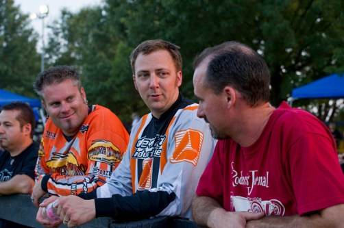 """Tim Strange, DW Horton, and Dave Neale go over race strategy. """"I'm going to stay on the bike this year, and since there are only three people in my race I'll make the podium."""""""