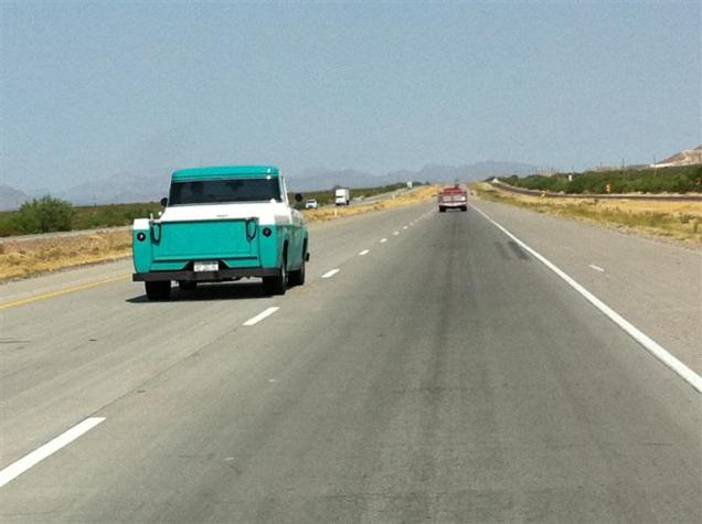 "A Road Tour member passing us. Neat, clean 1960 Ford truck. Front plate reads: ""Grandpa bought it, I've still got it."""