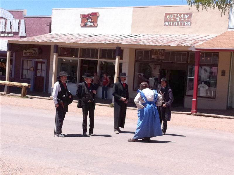 Gunfighters being verbally abused in the middle of the street. She had a rolling pin at one point.
