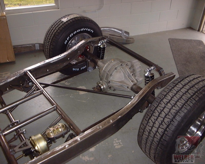 A diagonal locator works like a Panhard bar, triangulating the rear suspension. If a Panhard isn't easy to hook up, this might be a good option.