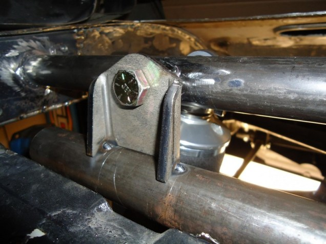 This is the sway bar mount, which is mounted through the upper coilover bolt.