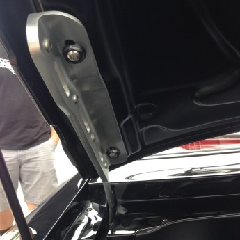 Cool hood hinge. The one section is bolted to the hood, and the other is attached to the body. If you look close, the angled piece is actually two pieces bolted together. You could unbolt the hood without losing the alignment.