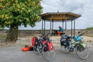 Cyclists having lunch under a Chinese pavilion
