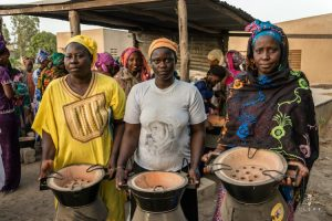 African women with new energy efficient cooking stove