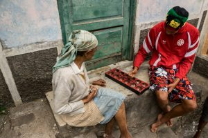 Mother and son playing traditional game in Cape Verde