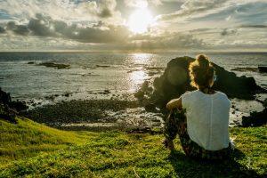 Girl watching sunrise in Fernando de Noronha