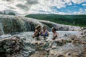 Family swimming in natural pools in Lencois in Chapada Diamantina