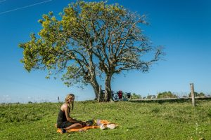 Cyclist having a lunch break under a tree in Brazil