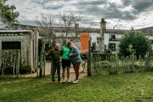 Family in front of their farm in Uruguay