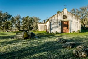 Hilleberg Nallo GT3 tent pitched next to an old church