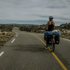Cyclist on a abandoned mountain road