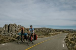 Two cyclist on a small mountain road