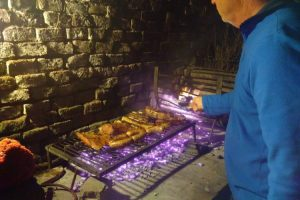 Man cooking an asado in Argentina