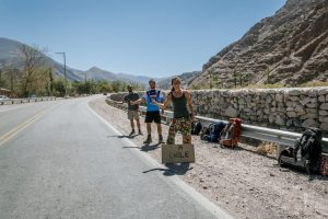 Friends hitchhiking to Chile in Purmamarca