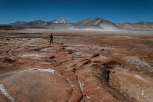Tourist posing on the piedras rojas in San Pedro de Atacama
