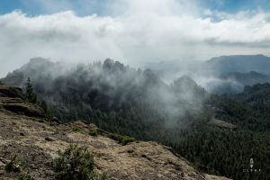 Low hanging clouds on top of Roque Nublo in Gran Canaria