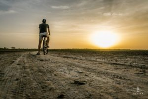 Cyclist watching the sunset in Senegal