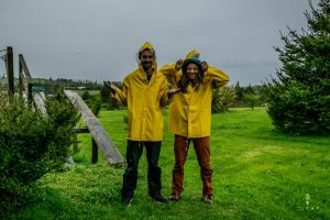 Couple testing brand new yellow rain coats in Chile