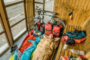 Saving the world trip budget. Sleeping in a modern bus shelter in Chile