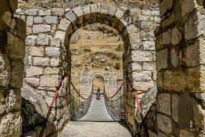 cycling on a old stone bridge in Peru