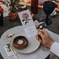 10-The-place-settings-were-done-with-woven-placemats-wooden-bowls-and-fruity-and-flower-cards