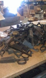 A box of Mauser bottom metal just dumped for sorting.