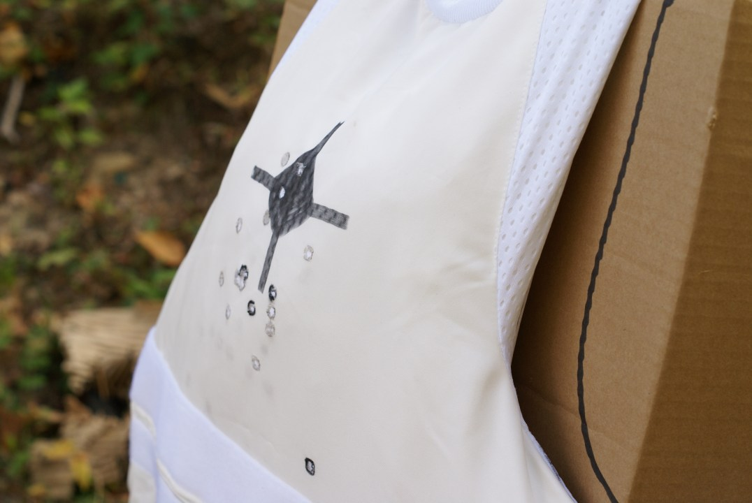 An additional thirteen rounds of the 9mm 124 grain +P Speer Gold Dot hollow points were fired into the Stealth vest for a total of seventeen. The panel captured all of them. The dark circles are the original four test rounds.