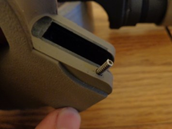 The safety detent spring slips into the top of the grip.