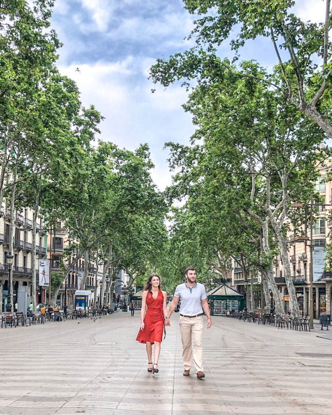 Couples Walks Down Las Ramblas