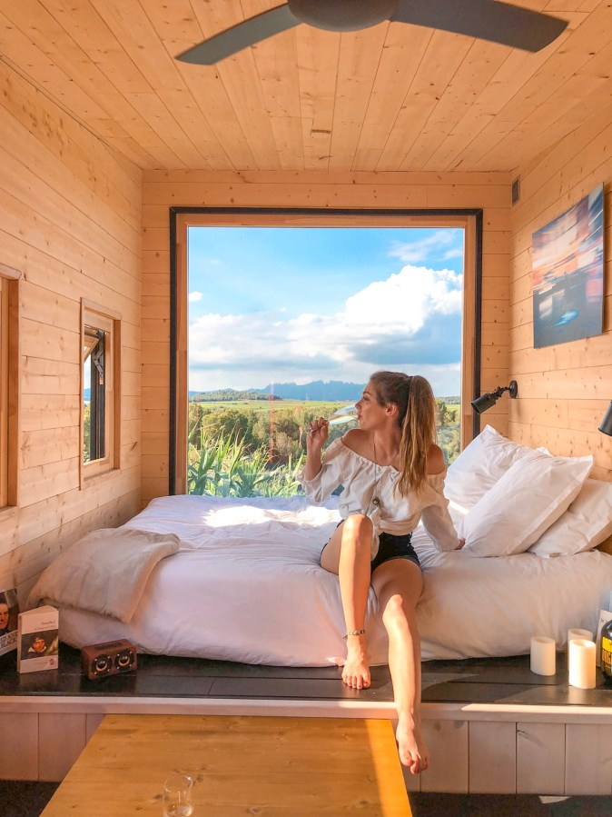 Woman Sips Cava in Tiny Home