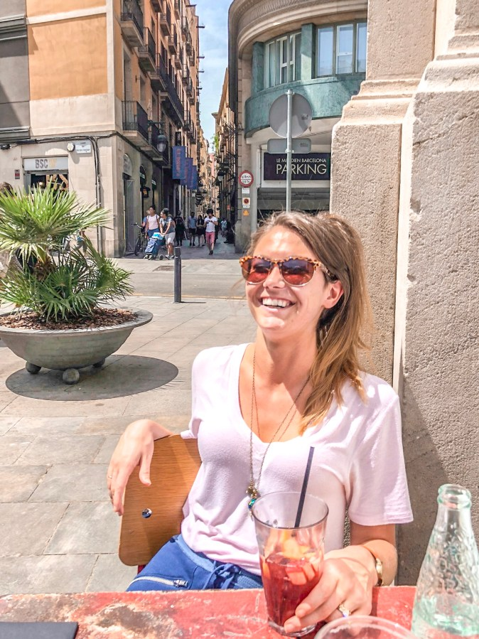 Woman Enjoys Sangria in Barcelona
