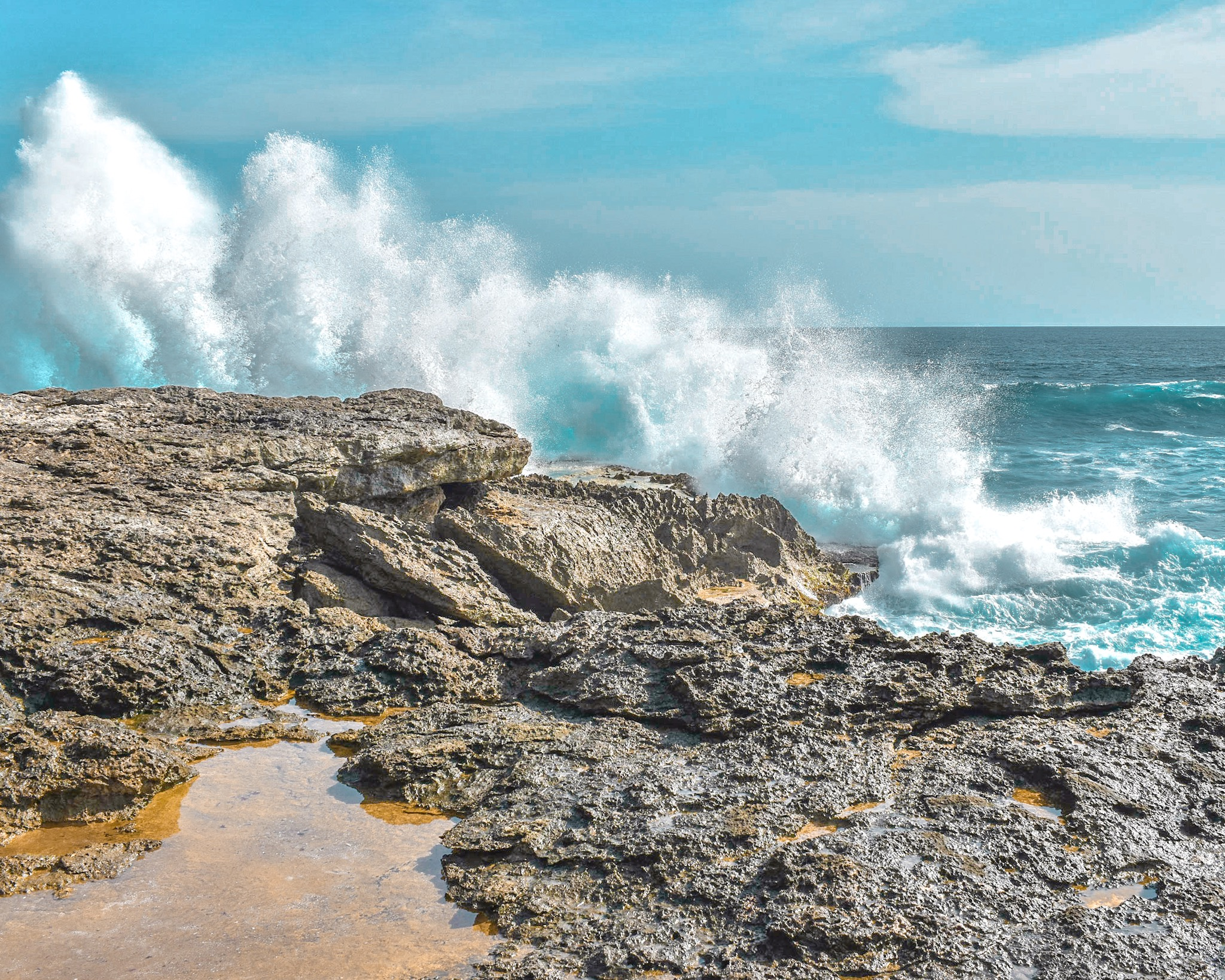Waves Crash Into the Cliffs at Dream Beach on Lombok Island