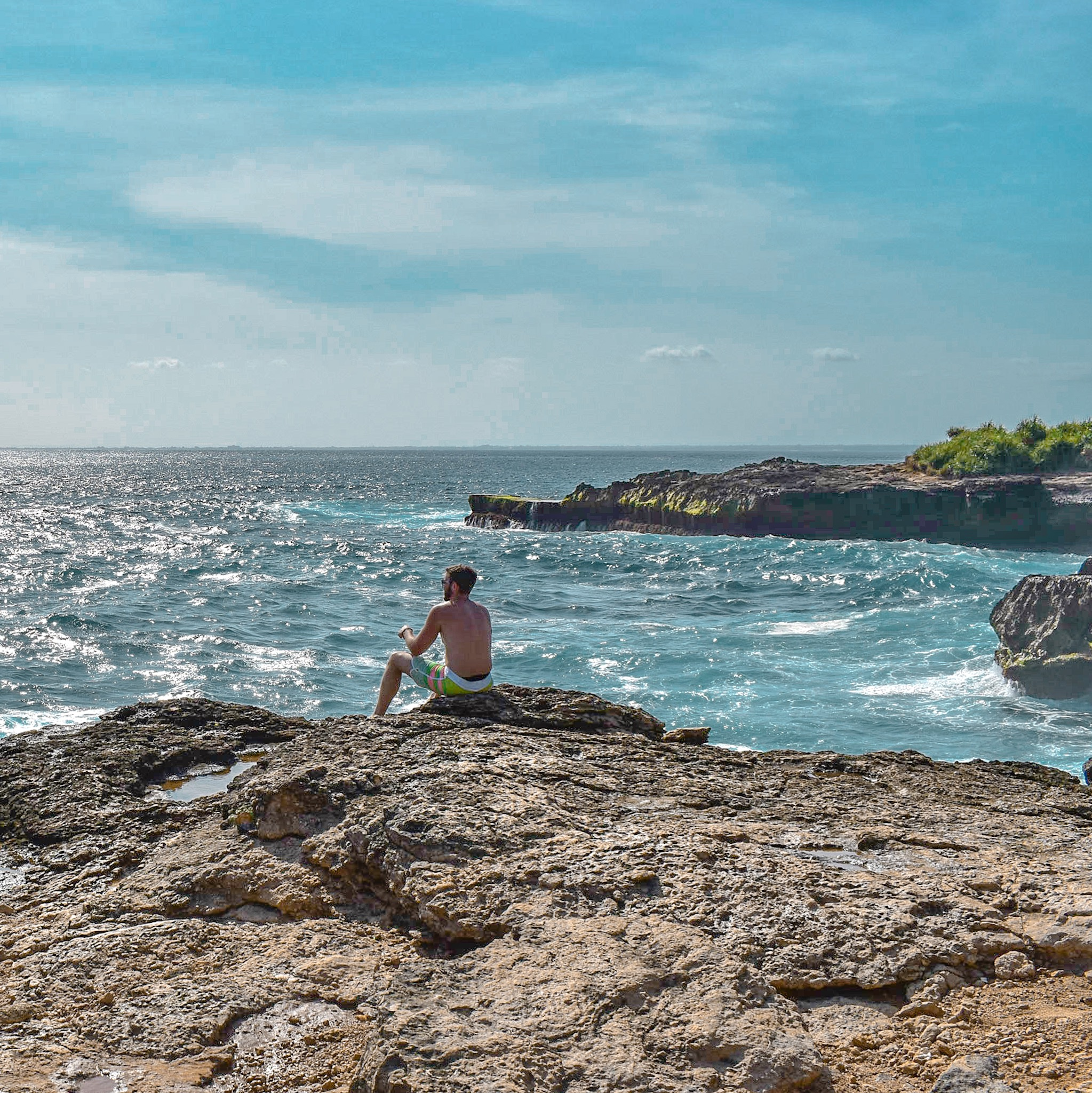 Man Views the Waves on Dream Beach on Lombok Island