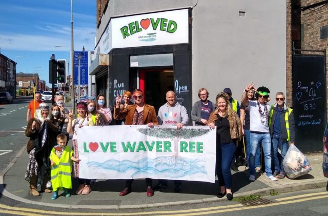 Volunteers standing outside the ReLoved shop after a Beatles themed Litter Pick