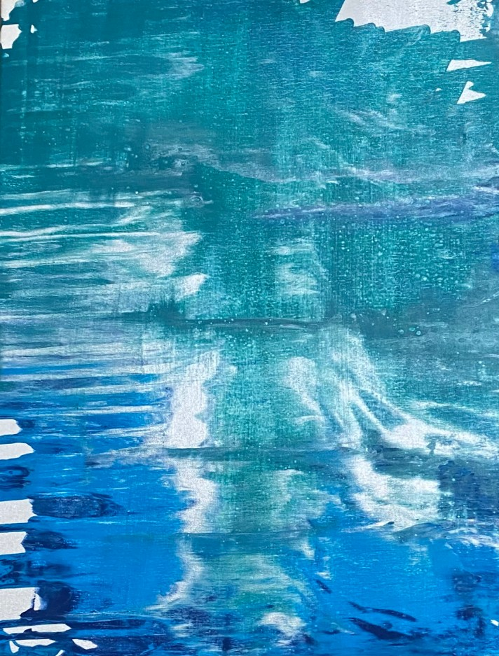 Mix of teal and blue paints poured horizontally on the canvas to create a body of water with the suggestion of an outline of a woman in silver woman emerging from it