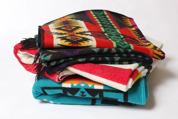Pendleton wool blankets in their characteristic designs.