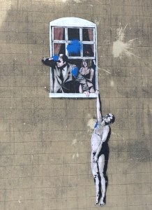 An authentic Banksy piece on a wall in the centre of Bristol.