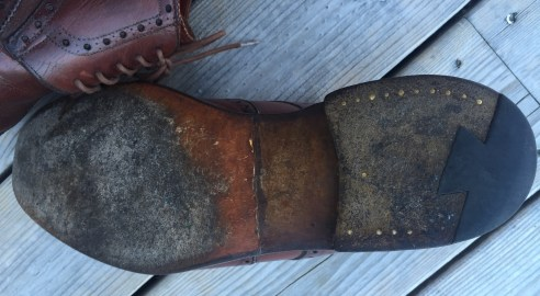 The leather sole and heel is in need of work though. At some point a half-sole has been applied, though the heel is now very worn down.