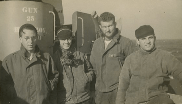 Crewmen on a navy ship during WW2, enjoying the utility of their deck jackets.