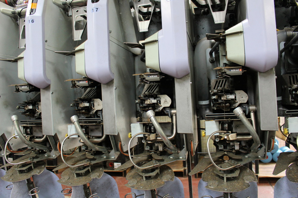 This is the machine that checks the yarn for uniform diameter and sufficient strength and splices the yarn if it breaks.